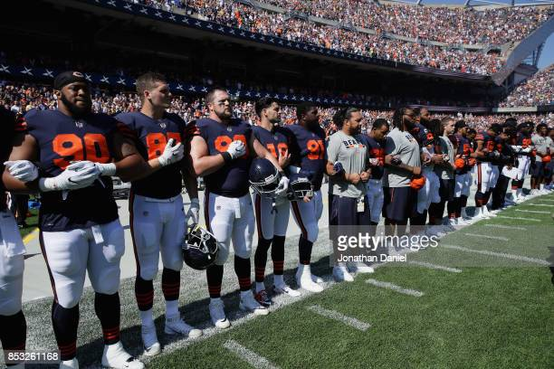 Members of the Chicago Bears stand arminarm during the National Anthem before a game against the Pittsburgh Steelers at Soldier Field on September 24...