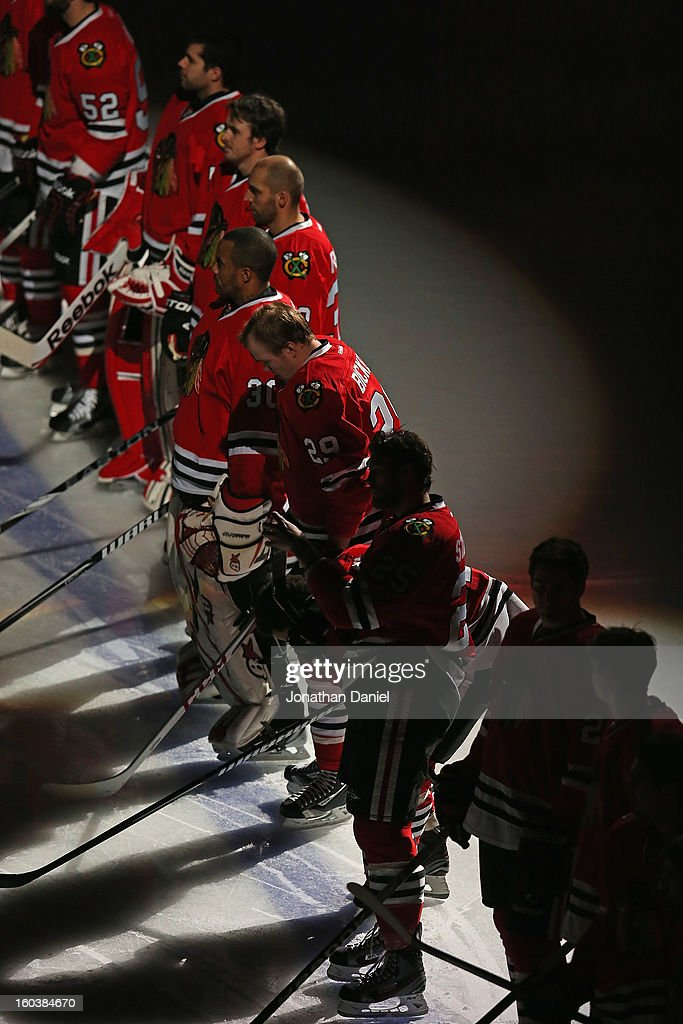 Members of the Chicago Blackhawks are introduced before a game against the St. Louis Blues at the United Center on January 22, 2013 in Chicago, Illinois. The Blackhawks defeated the Blues 3-2.