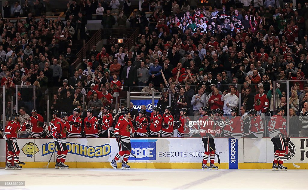 Members of the Chicago Blackhawks celebrate a goal against the Minnesota Wild at the United Center on March 5, 2013 in Chicago, Illinois. The Blackhawks defeated the Wild 5-3.