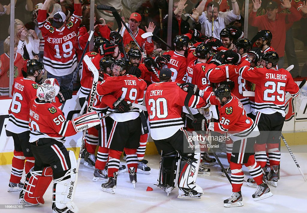Members of the Chicago Blackhawks celebrate a win against the Detroit Red Wings in Game Seven of the Western Conference Semifinals during the 2013 NHL Stanley Cup Playoffs at the United Center on May 29, 2013 in Chicago, Illinois. The Blackhawks defeated the Red Wings 2-1 in overtime.
