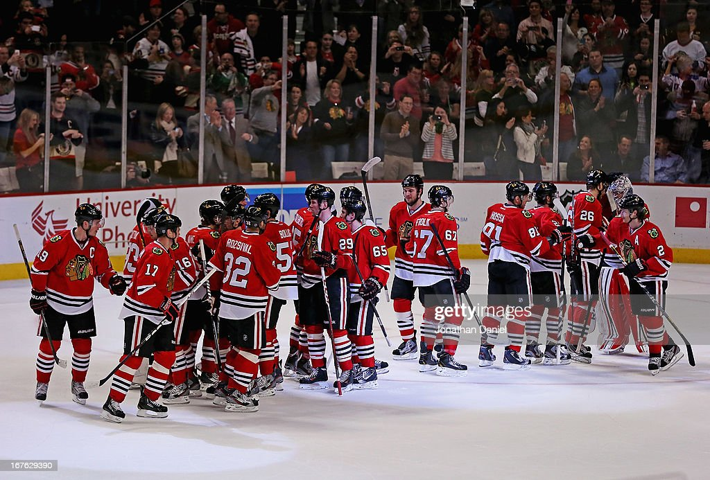 Members of the Chicago Blackhawks celebrate a win over the Calgary Flames in the last regular season game at the United Center on April 26, 2013 in Chicago, Illinois. The Blackhawks defeated the Flames 3-1.