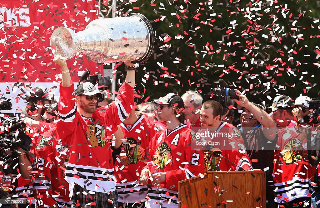 Members of the Chicago Blackhawks celebrate at a rally in Grant Park on June 28, 2013 in Chicago, Illinois. The Blackhawks defeated the Boston Bruins in 6 games to win the National Hockey League's Stanley Cup for the second time in four seasons.