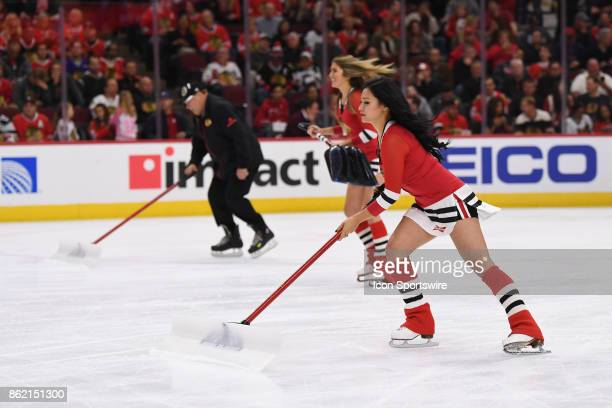 Members of the Chicago Blackhawks Ice Crew in action during a game between the Chicago Blackhawks and the Minnesota Wild on October 12 at the United...