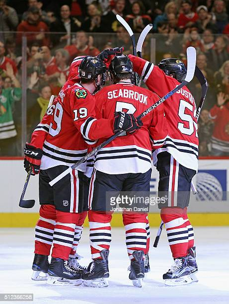 Members of the Chicago Blackhawks including Jonathan Toews and Erik Gustafsson congratulate Brent Seabrook on his second period goal against the...