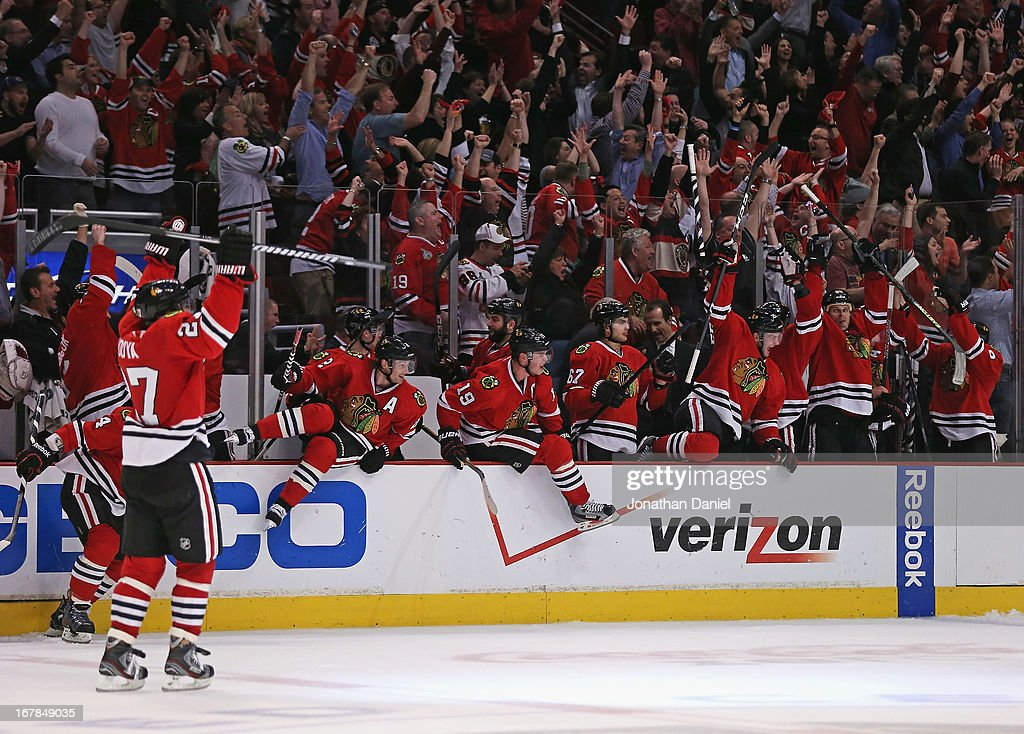 Members of the Chicago Blackhawks jump onto the ice to celebrate a win against the Minnesota Wild in Game One of the Western Conference Quarterfinals during the 2013 NHL Stanley Cup Playoffs at the United Center on April 30, 2013 in Chicago, Illinois. The Blackhawks defeated the Wild 2-1 in overtime.