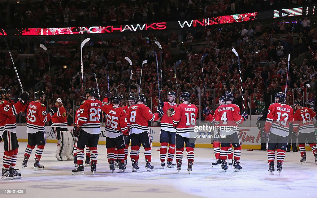 Members of the Chicago Blackhawks salute the corwd after a win over the Minnesota Wild in Game Five of the Western Conference Quarterfinals during the 2013 NHL Stanley Cup Playoffs at the United Center on May 9, 2013 in Chicago, Illinois. The Blackhawks defeated the Wild 5-1 to win the series.