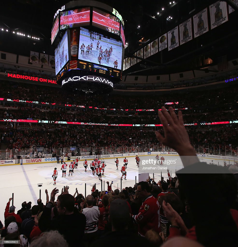 Members of the Chicago Blackhawks salute the crowd after a win over the Nashville Predators at the United Center on April 7, 2013 in Chicago, Illinois. The Blackhawks defeated the Predators 5-3.
