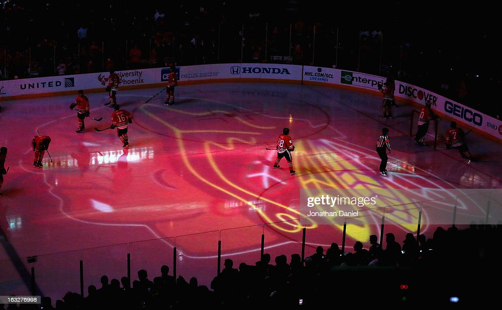 Members of the Chicago Blackhawks skate during player introductions before a game against the Colorado Avalanche at the United Center on March 6, 2013 in Chicago, Illinois.