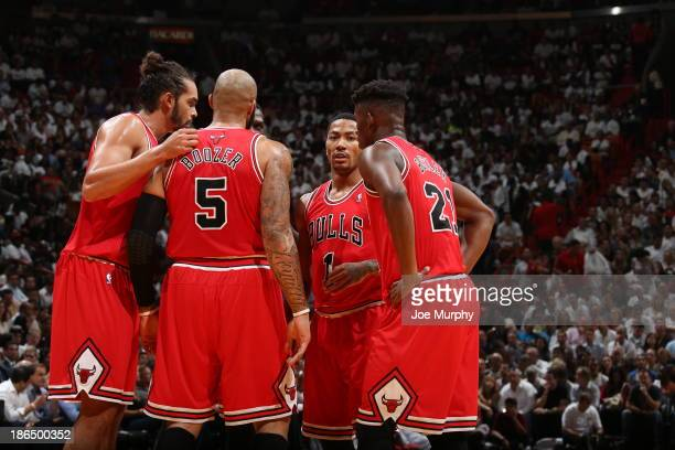 Members of the Chicago Bulls huddle against the Miami Heat on October 29 2013 at American Airlines Arena in Miami Florida NOTE TO USER User expressly...