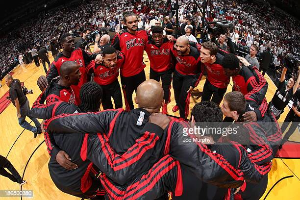 Members of the Chicago Bulls huddle against the Miami Heat on October 29 2013 at AmericanAirlines Arena in Miami Florida NOTE TO USER User expressly...