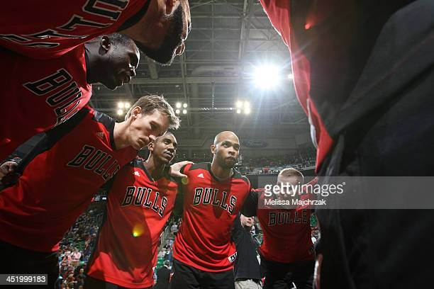 Members of the Chicago Bulls huddle prior to a game against the Utah Jazz at EnergySolutions Arena on November 25 2013 in Salt Lake City Utah NOTE TO...