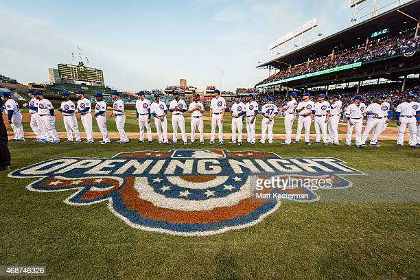 Members of the Chicago Cubs are seen on the base path during the pregame ceremony before the Opening Night game against the St Louis Cardinals at...