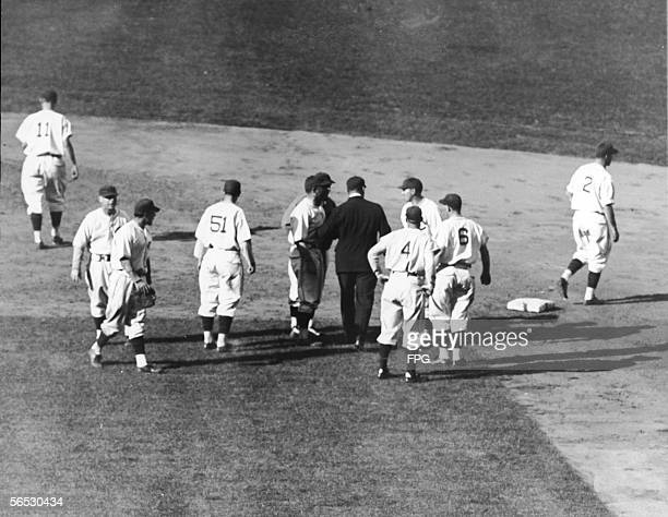 Members of the Chicago Cubs baseball team protest umpire George Moriarty and his decisiion to call Phil Cavarretta out after an attempted steal...