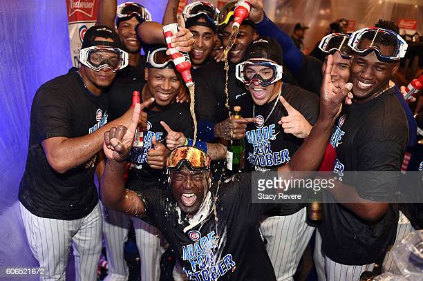 Members of the Chicago Cubs celebrate in the locker room following a victory over the Milwaukee Brewers at Wrigley Field on September 16 2016 in...