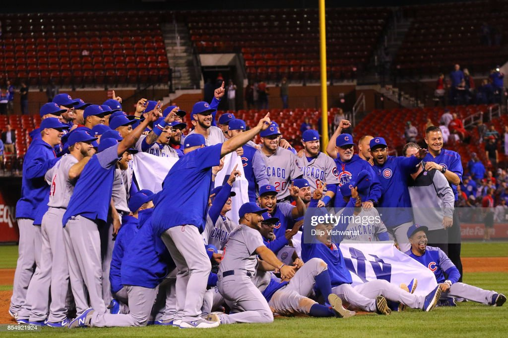 Members of the Chicago Cubs pose for a photograph after winning the National League Central title against the St. Louis Cardinals at Busch Stadium on September 27, 2017 in St. Louis, Missouri.