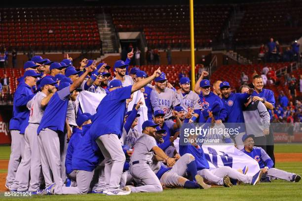 Members of the Chicago Cubs pose for a photograph after winning the National League Central title against the St Louis Cardinals at Busch Stadium on...
