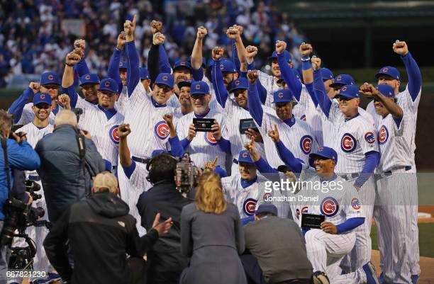 Members of the Chicago Cubs show off their World Series Championship rings before a game against the Los Angeles Dodgers at Wrigley Field on April 12...