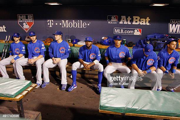 Members of the Chicago Cubs starting lineup sit in the dugout prior to the National League Wild Card game between the Pittsburgh Pirates and the...