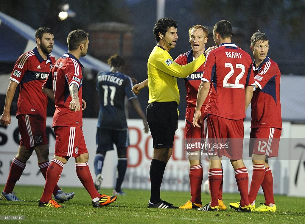 Members of the Chicago Fire protest a call by the referee during the second half of a game against the Vancouver Whitecaps FC at Blackbaud Stadium on February 23, 2013 in Charleston, South Carolina.