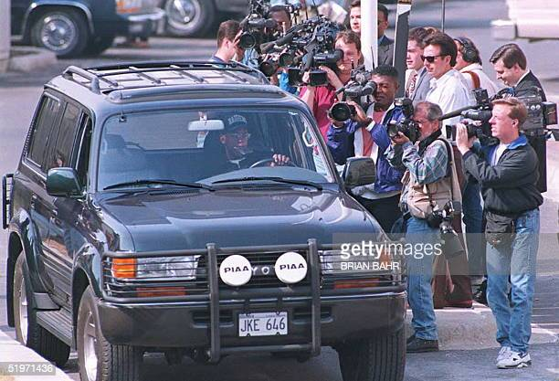 Members of the Chicago media surround the entrance to the Bulls practice facility in Deerfield Illinois 15 March as player B J Armstrong drives by in...