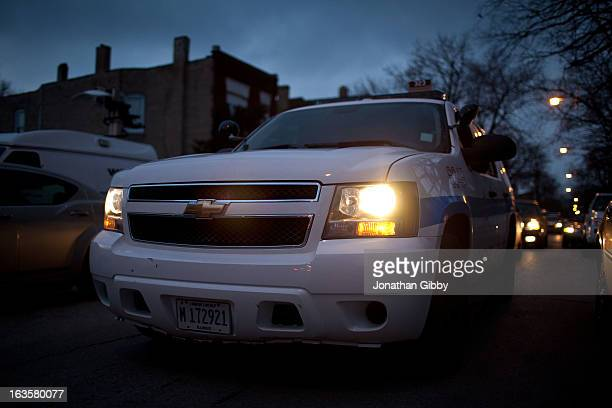 Members of the Chicago Police Department look arrive at a vigil for slain infant Jonylah Watkins on March 12 2013 in Chicago Illinois The 6monthold...