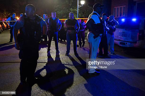 Members of the Chicago Police Department stand together at the scene of a fatal shooting in the 700 block of North Ridgeway Avenue Sunday June 26 in...