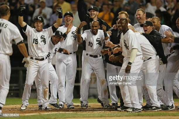 Members of the Chicago White Sox including Gordan Beckham and Alexei Ramirez welcome Jordan Danks who hit a walkoff home run to defeat the Oakland...