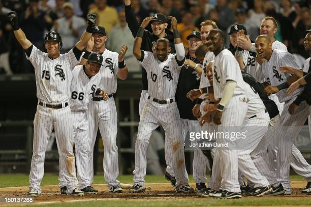 Members of the Chicago White Sox including Gordan Beckham Ray Olmedo Tyler Flowers and Alexei Ramirez welcome Jordan Danks who hit a walkoff home run...