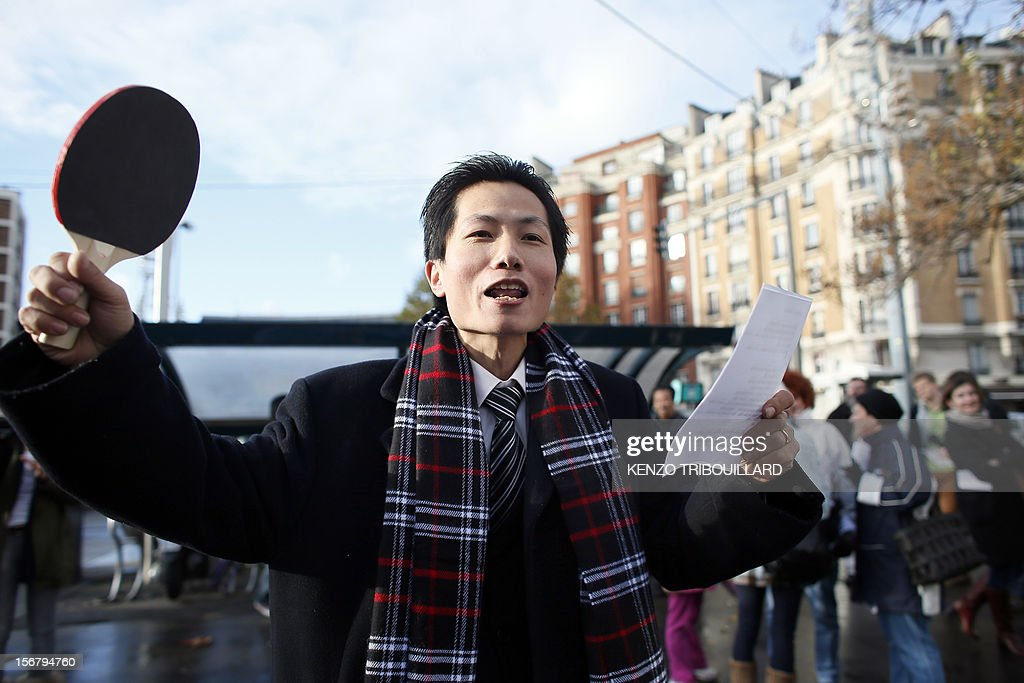 Members of the Chinese community in France take part in a demonstration against xenophobia called by the association 'Francais de Chine, Chinois de France' (French from China, Chinese of France) on November 21, 2012 near the French newspaper Le Parisien's headquarters in Saint-Ouen, a northern suburb of Paris. Demonstrators denounce the stereotypes their community is subjected to after Le Parisien published on November 11 a special issue on the Chinese maffia in France. AFP PHOTO / KENZO TRIBOUILLARD