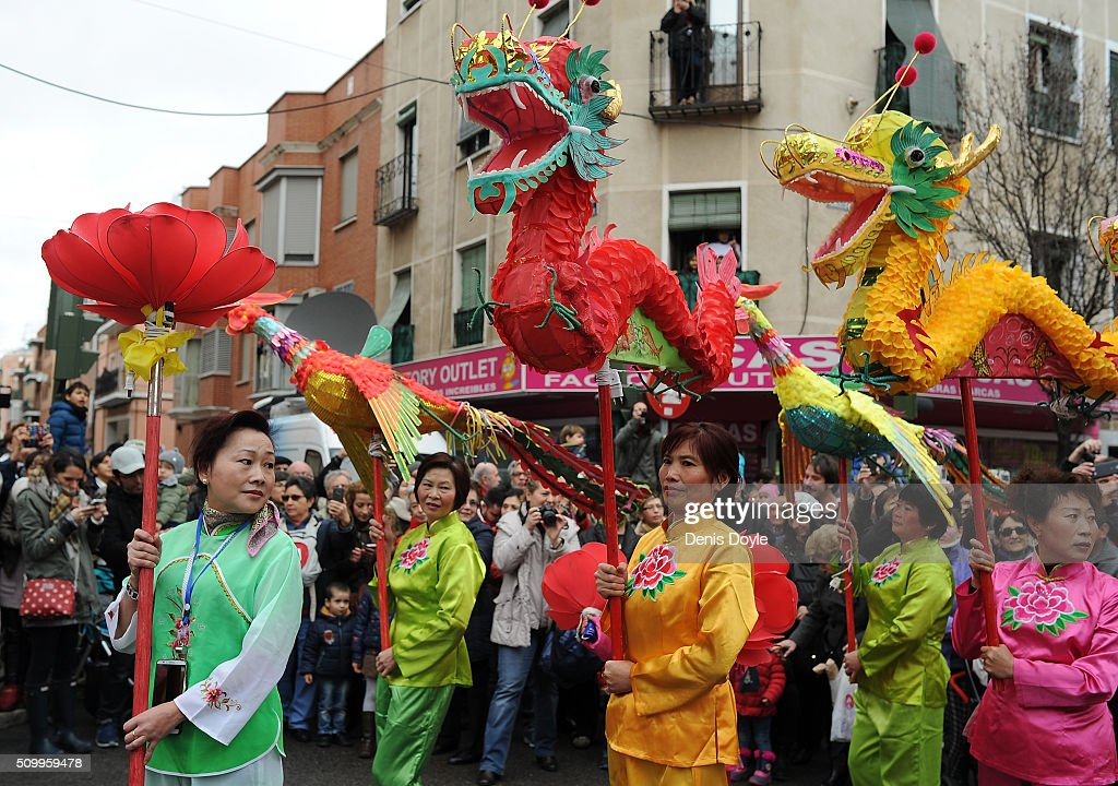 Members of the Chinese community in Madrid hold a procession to celebrate The Year of The Monkey on February 13, 2016 in Madrid, Spain. The Madrid Town Hall has organised this year's lunar year celebrations for the first time in Madrid's Chinatown district of Usera.