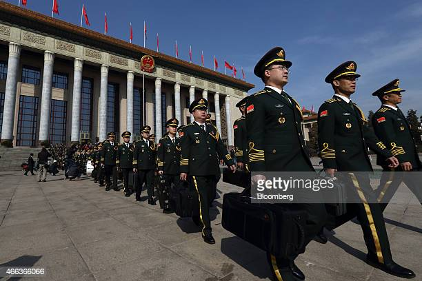 Members of the Chinese People's Liberation Army band leave the Great Hall of the People after the closing session of the third session of the 12th...