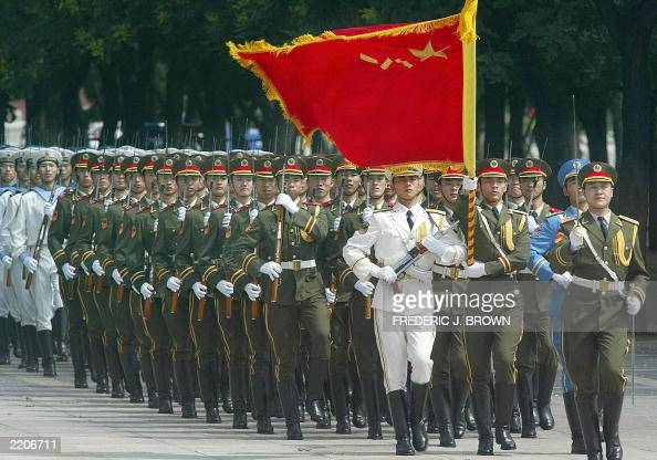 Members of the Chinese People's Liberation Army honour guard lead a military display during a welcoming ceremony for visiting Indian Prime Minister...