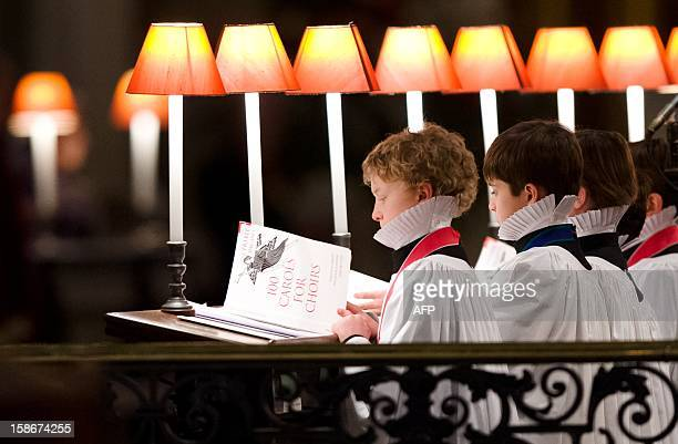 Members of the choir perform in St Paul's Cathedral in central London during the Christmas carol service on December 23 2012 AFP PHOTO/Leon Neal