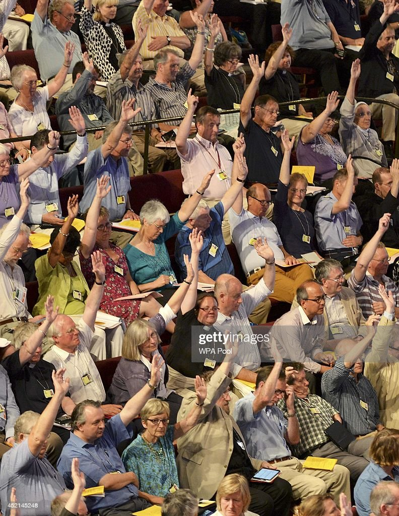 Members of the Church of England's Synod vote on one of the motions during the session to discuss and vote on the consecration of women bishops on...