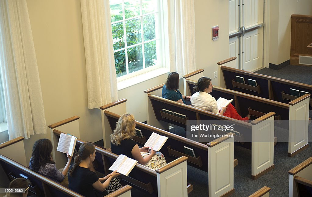 Members of the Church of Jesus Christ of Latterday Saints sing a hymn during a sacrament meeting inside the Longfellow Park Chapel Sunday July 22...