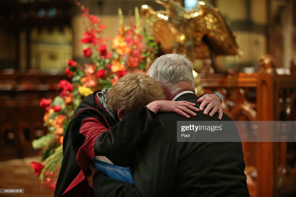 Members of the church share their grief at a Multifaith memorial service held for victims of the MH17 disaster at St Paul's Cathedral on July 24 2014...