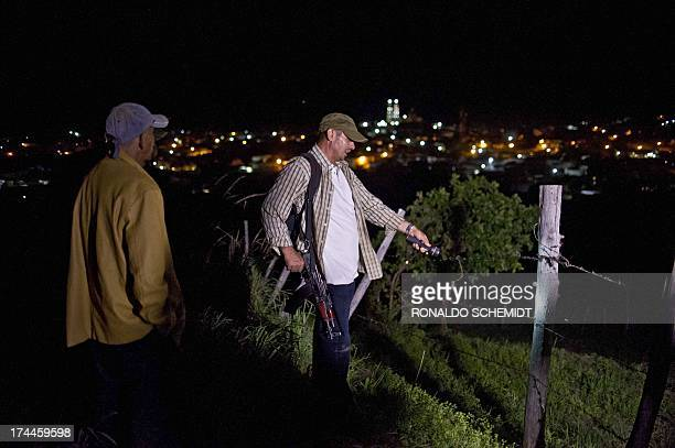 Members of the Citizens' SelfProtection Police stand guard in Aguililla Michoacan state Mexico on July 25 2013 Citizens settled groups to protect the...