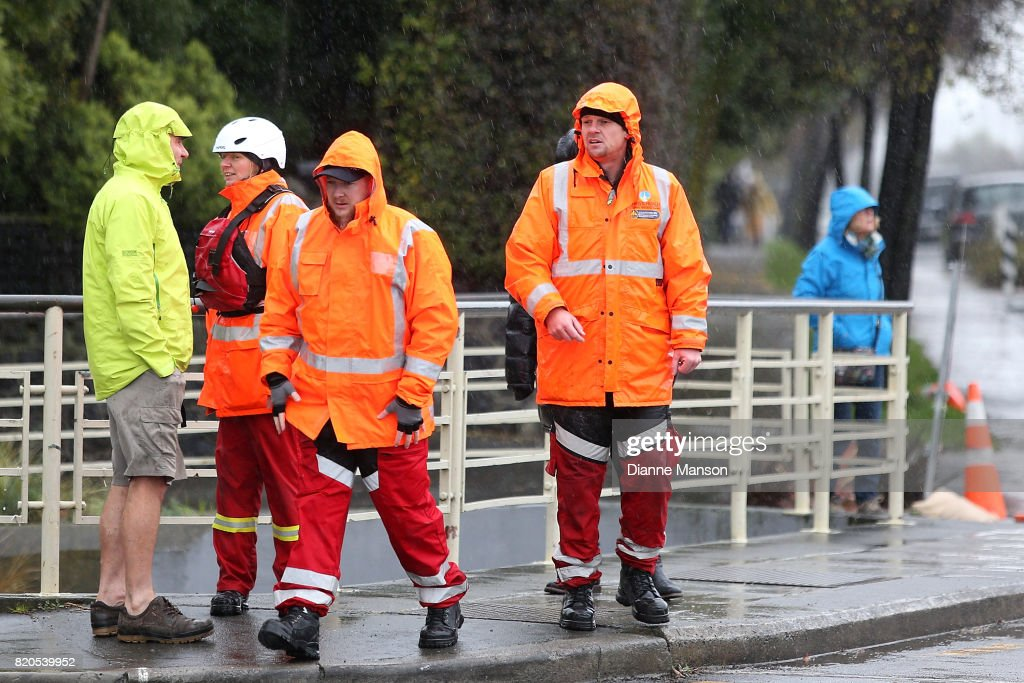 Members of the city council and coastguard gather to monitor the Heathcote river as it rises to high levels on July 22, 2017 in Christchurch, New Zealand. Heavy rain across the South Island in the last 24 hours has caused widespread damage and flooding with Dunedin, Waitaki, Timaru and the wider Otago region declaring a state of emergency. More rain is forecast today.