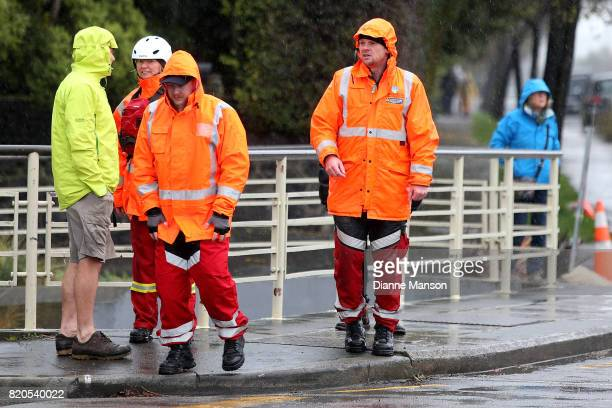 Members of the city council and coastguard gather to monitor the Heathcote river as it rises to high levels on July 22 2017 in Christchurch New...