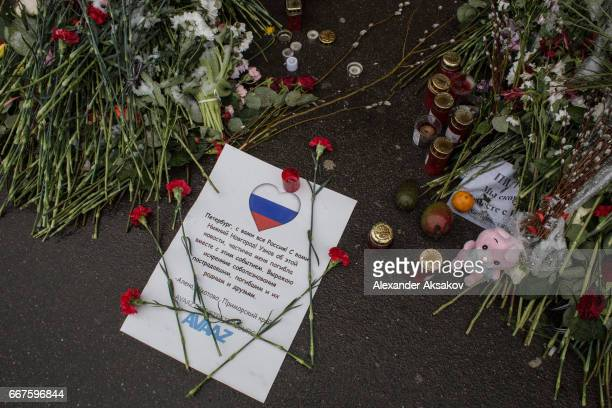 Members of the civic organization Avaaz show their solidarity with the citizens of St Petersburg after the recent Metro bombing by putting up...
