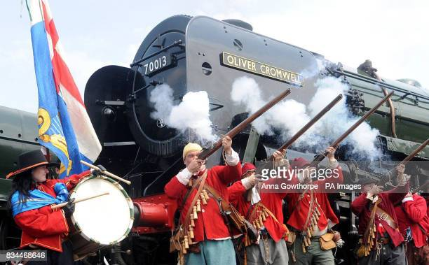 Members of the Civil War Society carry out a salute during a nine day celebration which started today to mark the return of the 'Oliver Cromwell'...