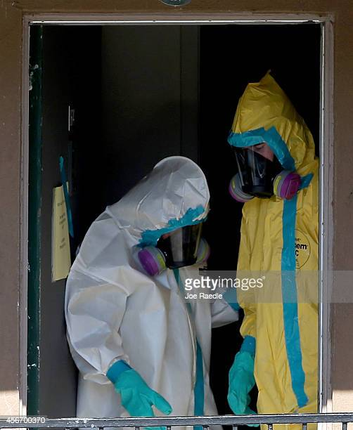 Members of the Cleaning Guys Haz Mat clean up company are seen as they sanitize the apartment where Ebola patient Thomas Eric Duncan was staying...
