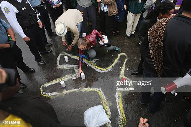 Members of the clergy and other demonstrators protest outside the Ferguson police station on October 13 2014 in Ferguson Missouri Ferguson has been...