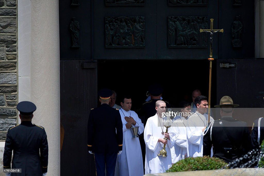 Members of the clergy exit St. Anthony of Padua Church after a mass of Christian burial was held for former Delaware Attorney General Beau Biden on June 6, 2015 in Wilmington, Delaware. U.S. President Barack Obama is expected to deliver a eulogy for the son of Vice President Joe Biden after he died at 46 following a two-year battle with brain cancer.
