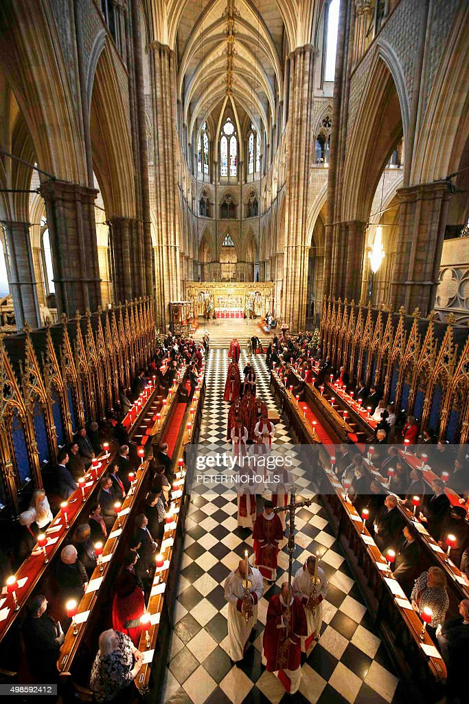 Members of the clergy process following service at Westminster Abbey in central London on November 24 on the occaision of the inauguration of the...