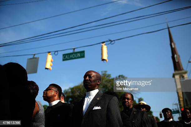 Members of the clergy wait to enter the funeral service where US President Barack Obama will deliver the eulogy for South Carolina State senator and...