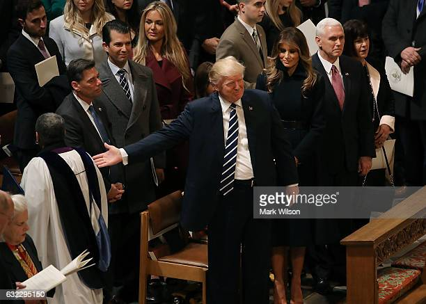 Members of the clergy walk past US President Donald Trump after National Prayer Service concluded at the National Cathedral on January 21 2017 in...