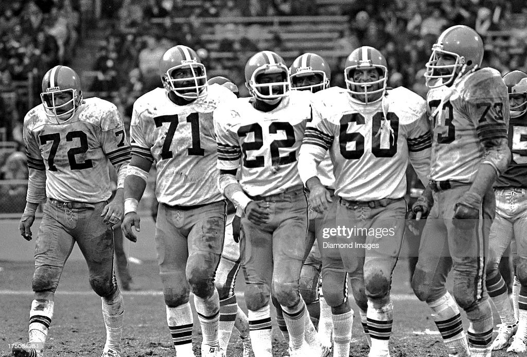 Members of the Cleveland Browns defense Jerry Sherk Walter Johnson Clarence Scott and Bob Babich walk off the field while offensive tackle Doug...