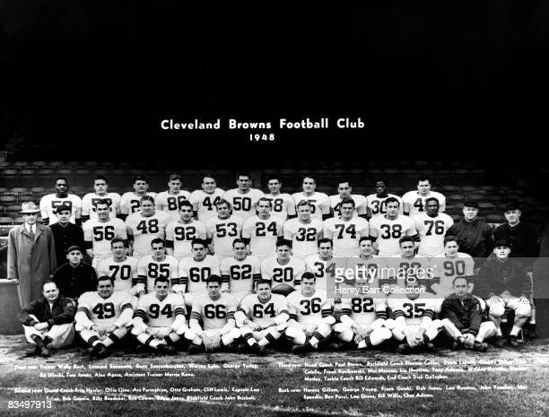 Members of the Cleveland Browns pose for a team portrait in 1948 at Municipal Stadium in Cleveland Ohio The members are trainer Walter Bock Leonard...