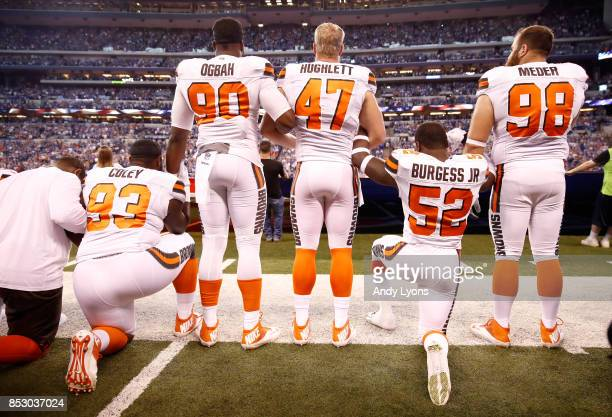 Members of the Cleveland Browns stand and kneel during the national anthem before the game against the Indianapolis Colts at Lucas Oil Stadium on...